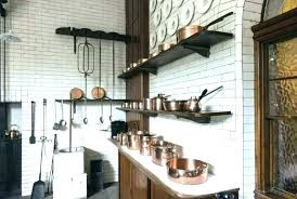 hanging pots on wall pans kitchen pot shelves and cast iron wal