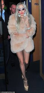 fashionista lady gaga covers up for winter in a fur coat but won