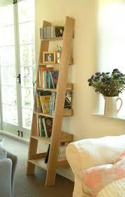 image ladder bookshelf design simple furniture. Oak Ladder Shelf With Wood And Sofa Also Cushion Image Bookshelf Design Simple Furniture F