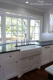 DWELLINGS-The Heart of Your Home: Kitchen Tour ~ Our NEW Farmhouse Style  Kitchen - can we move the giant kitchen window out?