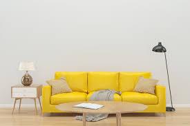 white wall yellow sofa interior background