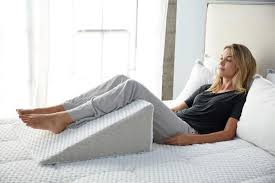 pillow under knees. under your knees. using a wedge pillow to elevate legs for better circulation knees l