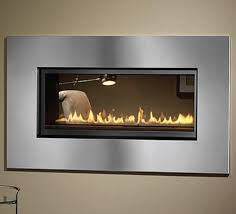 l52st see through gas fireplace with standard designer glass beads and optional stainless steel surround