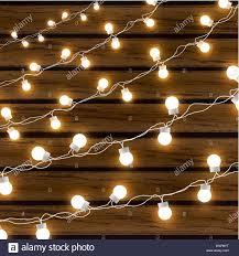 Christmas Lights That Look Like Light Bulbs Christmas Lights Isolated On Dark Wooden Background Glow