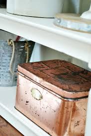 a vintage copper bread box