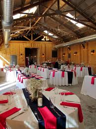 napkins and dishes for this bright fun rustic wedding reception at roca ridge events in roca nebraska we love the mix of round and rectangle tables