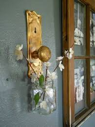 i turned antique copper door s into a way to hand vases on the wall
