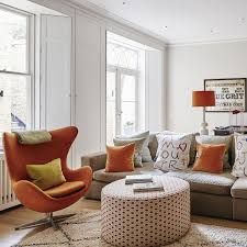 white living room with orange accents