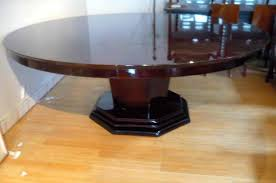 rare very large round dining table with one leaf the top made of rosewood rests on a octagonal leg and base it has been re varnished