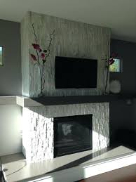 stacked stone fireplace painted white glacier surround contemporary