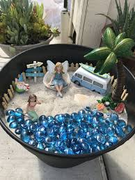 beach fairy garden all fairy accessories from michaels gems from the dollar sand bucket from home depot so adorable