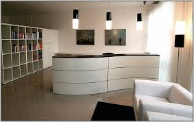 modern shaped pendant lamps with white ikea reception desk ideas and stylish leather armchair for chic office design