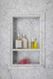 gray marble tile shower niche with