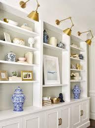 lighting for bookshelves. Brass Sconce Lights Over Built In Shelves. Lighting For Bookshelves B