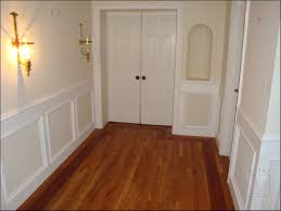 appealing wainscoting panels with wood tile flooring for entry room design