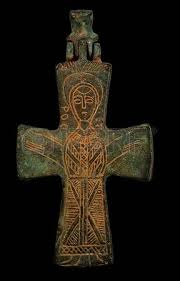 ancient copper cross with sain image isolated on black closeup shot ver=6
