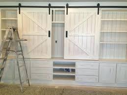 sliding barn door cabinet sliding barn door cabinets images about sliding barn doors on maple leaves
