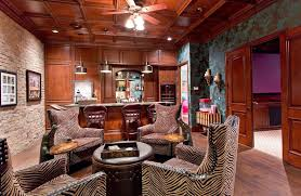 sy man cave bar with patterned chairs and door to room