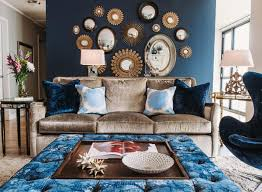 this blue wall is well dressed in gold and mirrored accents