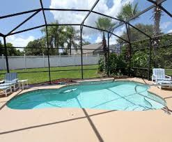inground pool covered by a screen enclosure swimming30