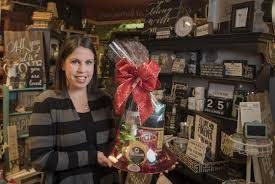 denielle waltermire stuhlmiller holds a signature gift basket in her gift simply northwest