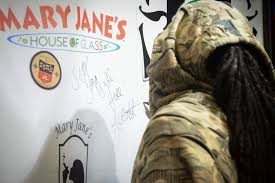 ian snoop dogg signs the photo backdrop at mary jane s house of grass on mill plain boulevard in vancouver during a during a meet and greet event