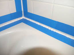 squeeze an even bead of caulk into and along the gap do this all in one caulking session some people recommend filling the tub 3 4 full with water