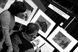 photo essay six days in vancouver the uc observer a couple examines class pictures at an exhibition of paintings created by students at the alberni n residential school on vancouver island