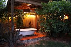 View in gallery Salvaged bathtub at the heart of a lovely backyard spa!  [Design: Swell Done