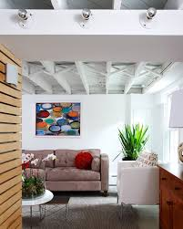 exposed ceiling lighting. Lighting For Exposed Ceilings Basement Modern With Grey Rug Wood Ceiling A