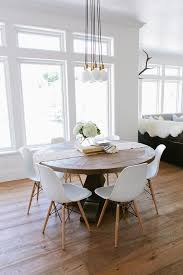 eat in kitchen boasts a schoolhouse electric brass city chandelier 7 illuminates a round salvaged wood dining table lined with eames molded plastic chairs