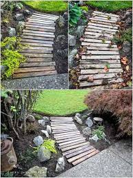 34 simple wooden planks creating a transition between gravel and grass 41 ingenious and beautiful diy garden path ideas