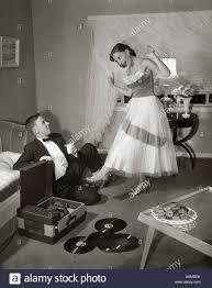Music Living Room 1950s 1960s Teen Couple In Living Room In Prom Dress Tuxedo Guy