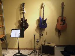 so i ve been hanging my guitars on the wall because they re pretty and it s cool but it was just a bit blah