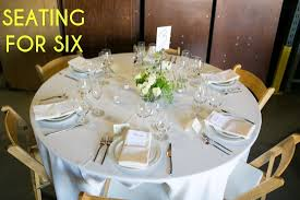 a table showing place settings for 6 persons