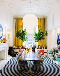 george nelson dining table with richard schultz chairs covered in alexander girard double triangles fabric from maharam two ficus in orange planters sit