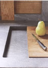 sink counter detail soap stone counter with inset cutting board which slides to cover sink