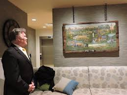 local artist dave barnhouse unveiled his painting of franciscan university of steubenville during an open house thursday evening at the inn at franciscan
