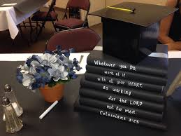 cute idea for graduation party use books as centerpiece graduation centerpiece use black butcher paper as a runner on top of a white table