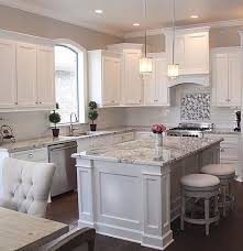best kitchen island with white cabinet and granite countertops