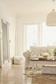 beachy decorating abeachcottage com coastal vintage style white sofa wicker pendant lamp jute