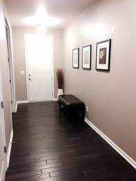 front entry with dark distressed hardwood floors sherwin williams perfect greige color on walls with