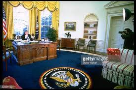 oval office pics. Distant Of Pres Bill Clinton Talking On Phone At Desk In Oval Office Pics C