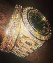 rick ross shows off his iced out jewelry on his wrist 2
