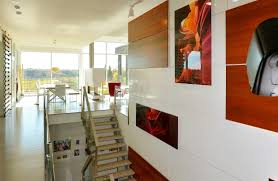My House Beautiful  Upside down layout scores big viewsThe central staircase is integral to the open floor plan and is also a showcase for