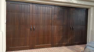 square trim dark stain wood garage door in rancho mirage