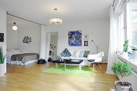 Inspiring All-In-One-Room Apartment in Stockholm Shop this look: rug,  chair, couch.