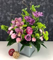 pink and purple hypoallergenic flowers including cymbidium orchids roses alstromerias and bells