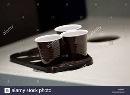office coffee cups. THREE DISPOSABLE CUPS AND TRAY IN AN OFFICE. - Stock Image Office Coffee Cups