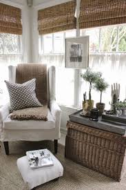 picture hung on framing between windows wicker trunks for storage and galvanized trays will prevent amusing decor reading corner furniture full size